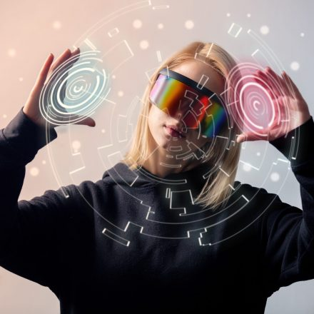 female programmer works with personal data in virtual glasses